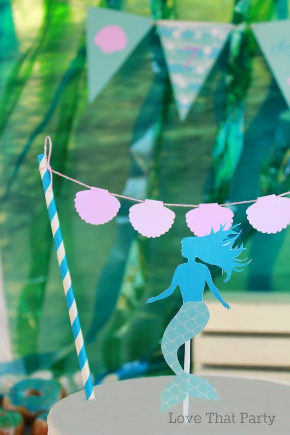 close up of mermaid birthday cake bunting cake decorations