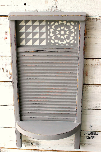 Photo of a painted, stenciled washboard with shelf