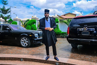 E-MONEY SHOWS OFF HIS CARS IN NEW PHOTO