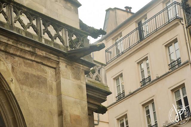 gargoyles in gothic church, apartment windows