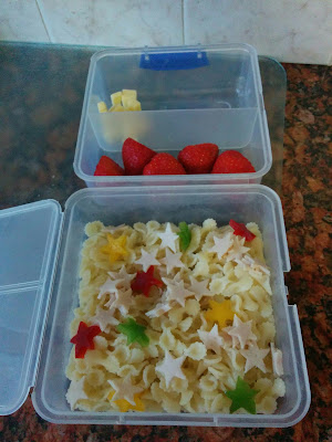 Pasta with Pepper and Turkey Breast Stars in a lunchbox along with some Cheese Squares and Strawberries