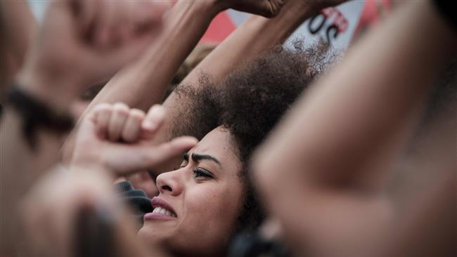 Brazilian demonstrators at Rio de Janeiro's Copacabana Beach demand President Michel Temer's resignation