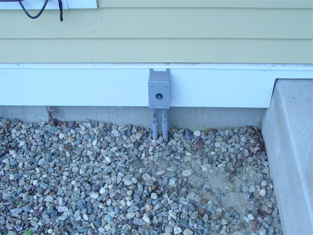 Conduits And Switch Boxes Positioned In The Wall Of A House Under