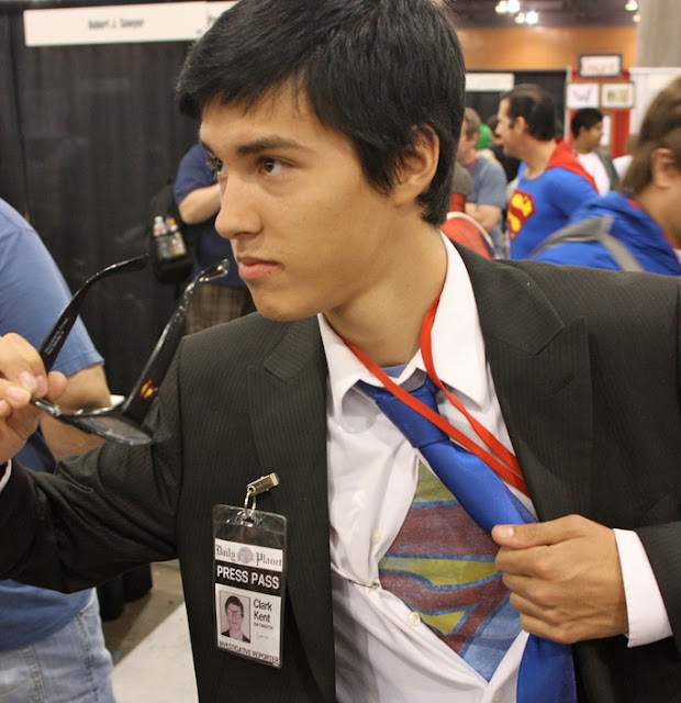 Image: Phoenix Comicon 2011: Clark Kent as Superman, by Kevin Dooley on Flickr
