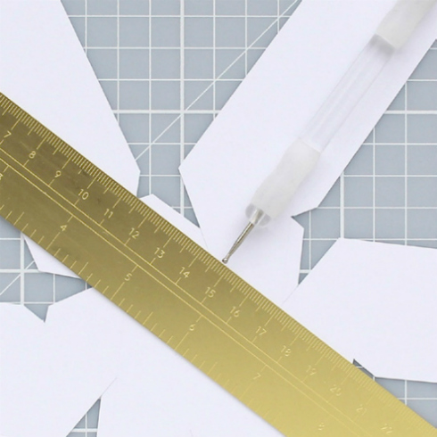 Embossing tool, ruler, and paper