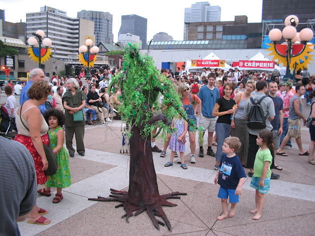 A person in a tree costume at the Montreal Jazz Festival