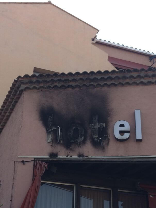 30 Hilarious Hotel Failures That Will Make Your Day - The Word 'Hot' In Hotel Caught On Fire
