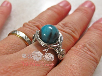 Wire wrapped Twice Around the World (TAW) Ring around finger