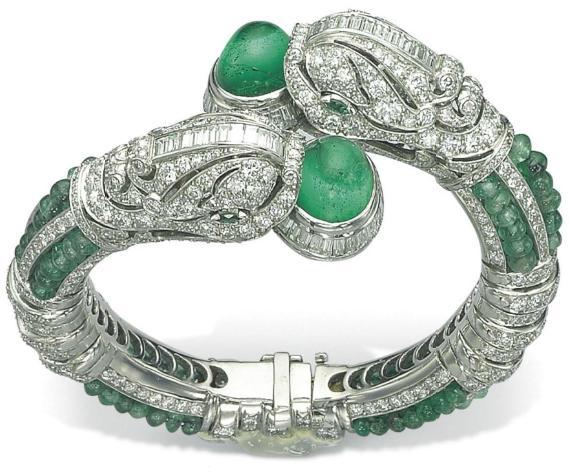 Emerald and diamond chimera bangle. Via Diamonds in the Library.