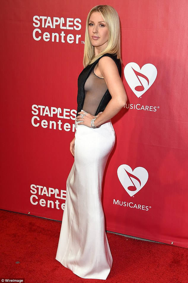 Ellie Goulding flashes sideboob at the MusiCares Gala in LA