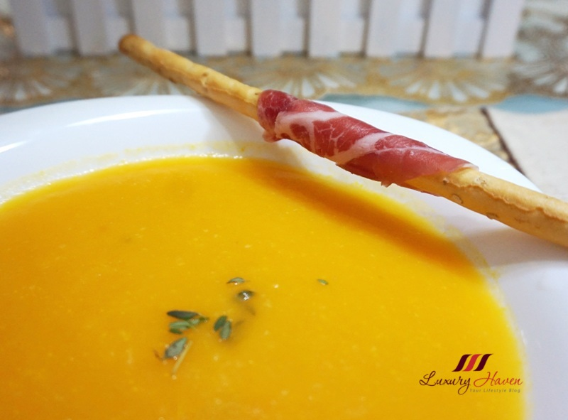 creamy carrot soup with parma ham wrapped grissini