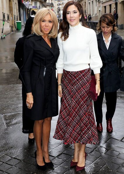 Crown Princess Mary wore a high-waisted bouclé tweed midi skirt by Alexander McQueen. he DR Danish National Girls' Choir