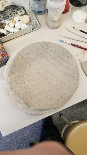 Hand stamped pottery by Lily L, in progress.