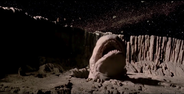 Exogorth, the giant space slug with its gaping jaw, trying to catch the Millennium Falcon