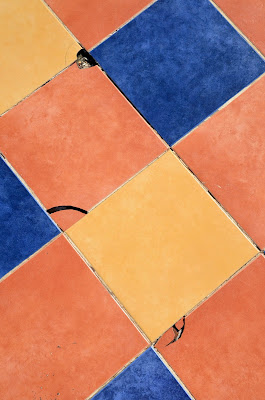 blue, light orange, and dark orange tiles set on the diagonal