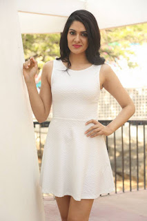 Actress Sakshi Chowdary Stills in White Short Dress at Lord Shiva Creations New Movie Launch  0028.jpg