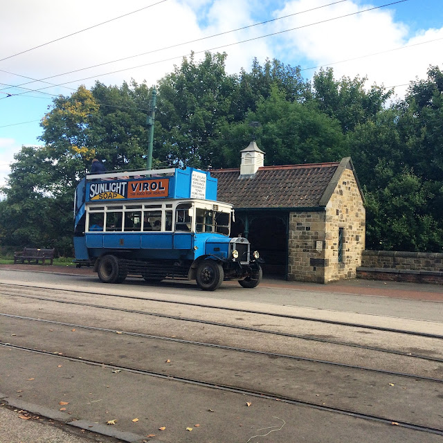 old fashioned open top blue bus at Beamish museum