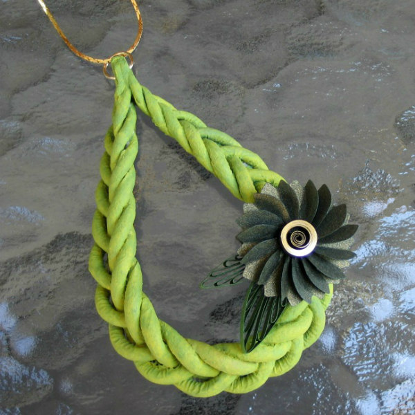 Lime green loosely braided Makigami Pendant with an olive green paper sculpture flower on a golden neckace chain
