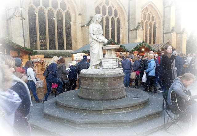 Bath Christmas Market, featuring large statue and digitally added snow