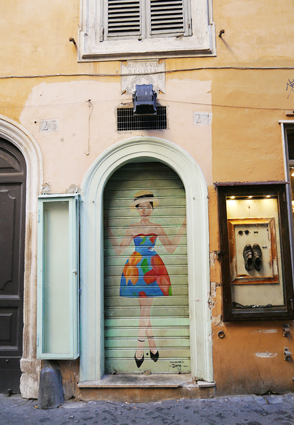 Street art of a woman in a strapless sun dress