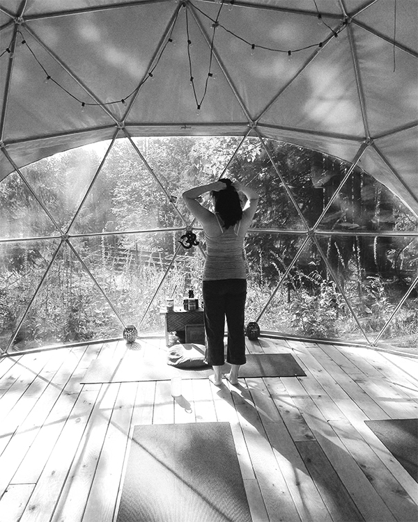 Vancouver beauty, life and style blogger Solo Lisa stands inside the yoga dome after a class at Nectar Yoga Bed and Breakfast located on Bowen Island in Horseshoe Bay.