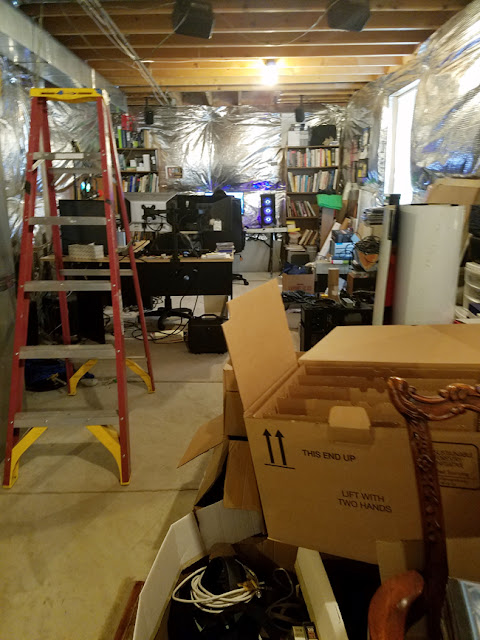 long view of disorganized basement.
