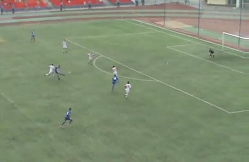 Sokol Saratov player Evgeny Shcherbakov shoots to score from long range against Spartak Tambov