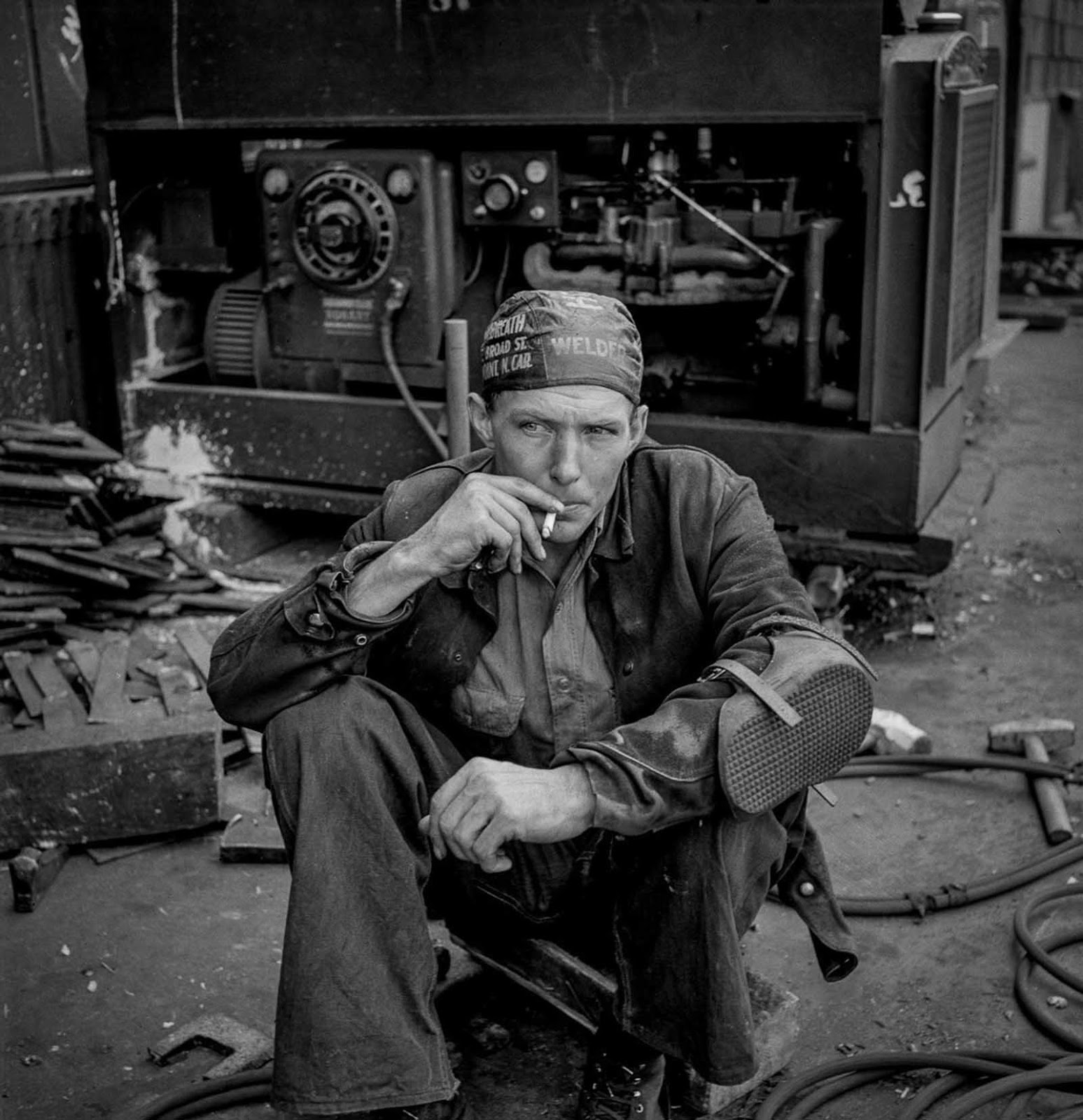 A welder rests during his lunch hour.