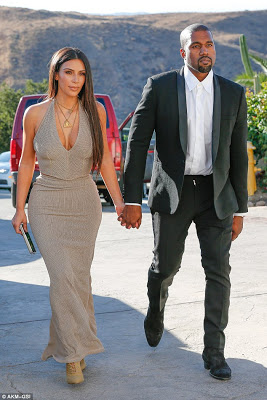 Kim Kardashian and Kanye West step out looking glamorous for a friend's wedding