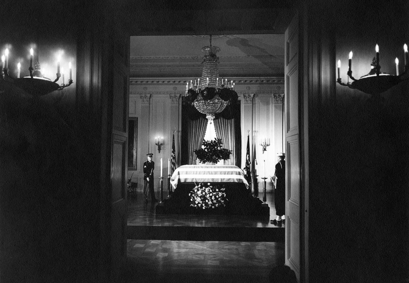 Kennedy's casket lying in state in the East Room of the White house, before it was moved to the Capitol Rotunda.