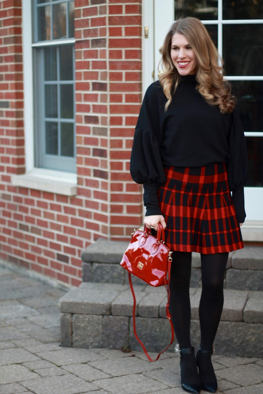 black lantern sleeve top, red patent leather satchel, red plaid skirt, Alterre shoe charms, black ankle strap heels