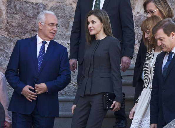 Queen Letizia wore Nina Ricci Pant Suit, Carolina Herrera patent and suede pumps and carried Uterque Studded messenger bag