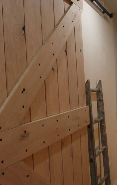 Pacific Entries rustic knotty alder barn door Hello Lovely Studio
