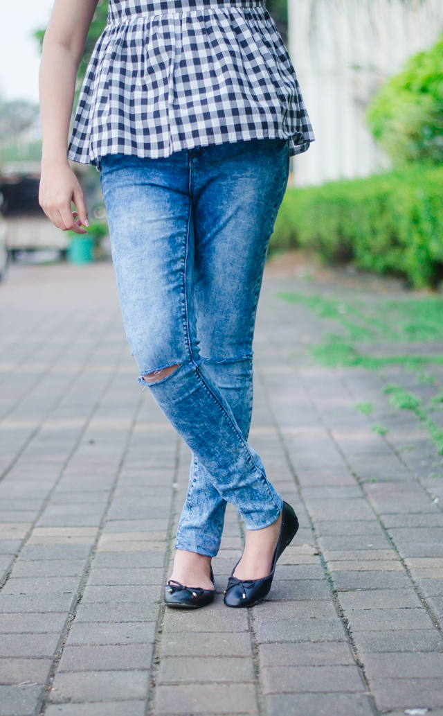 Gingham top with ripped jeans and ballet flats