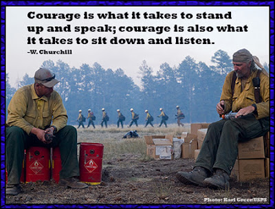 Courage is what it takes to stand up and speak; courage is also what it takes to sit down and listen - W. Churchill (Wildland firefighters sitting and talking while a crew is hiking in the background)
