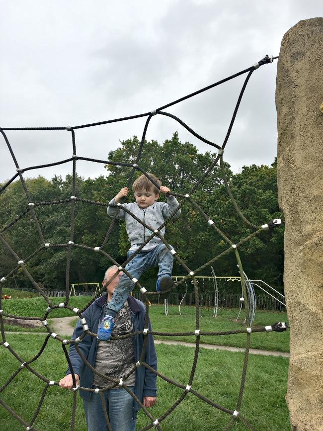boy-climbing-rope-frame