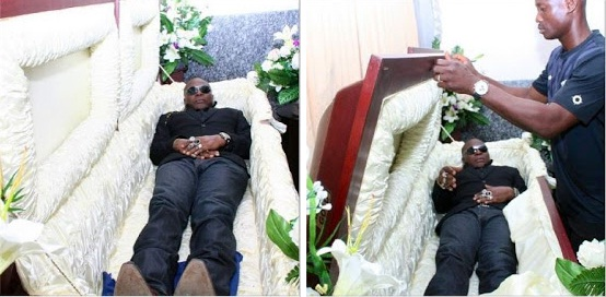 charly boy inside casket