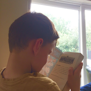 Anthony reading the AniMalcolm novel