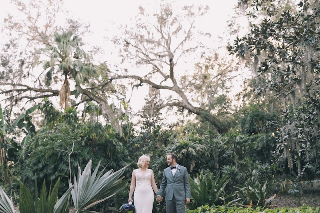 bride and groom in greenery and vegetation