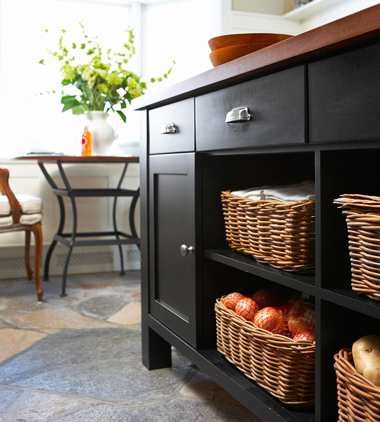 I love this slate flooring and wicker storage baskets - very modern mixed with country elements