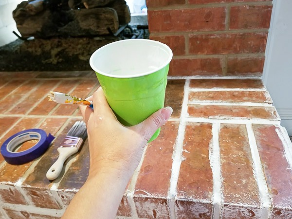 Solo cup filled with white chalk paint