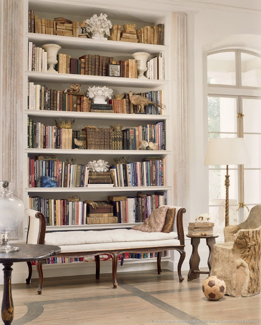 Elegant living room by Eleanor Cummings with bookshelves
