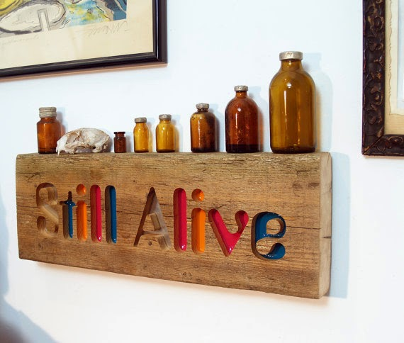 https://www.etsy.com/listing/159890928/wall-decor-sign-still-alive?ref=favs_view_1