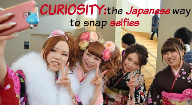 curiositythe Japanese way to snap selfies, youg Japanese girls taking a selfie