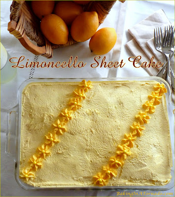 Limoncello Sheet Cake, this quick and easy sheet cake is bursting with lemon flavor. | Recipe developed by www.BakingInTornado.com | #cake #lemon