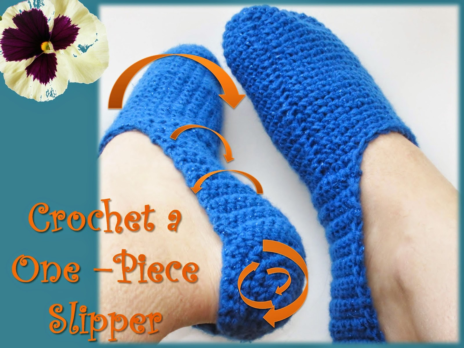 A bright blue crochet slipper with stitch direction arrows.