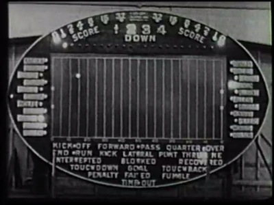 A black and white photograph of a scoreboard.
