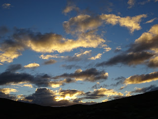 sunlit clouds at sunset