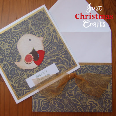 Patterned handmade Christmas greetings card with bird design