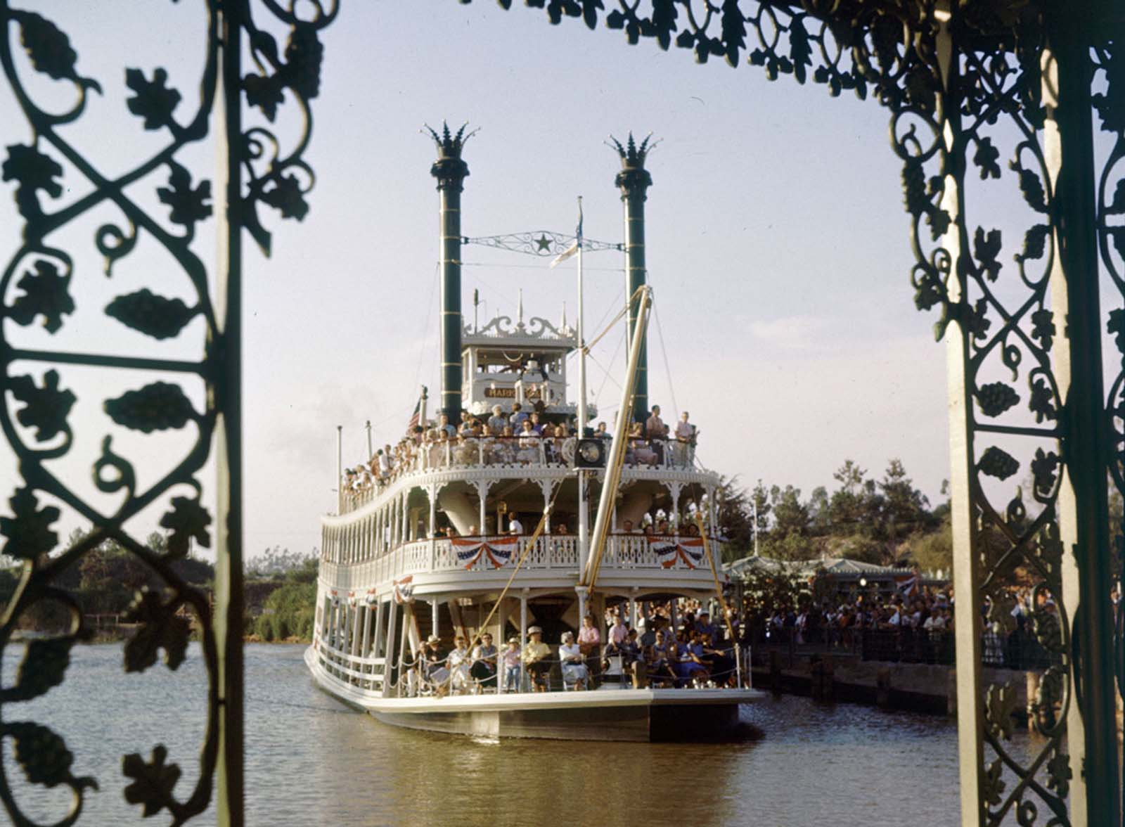 A crowded Mark Twain Riverboat sails at Disneyland in July 1955.